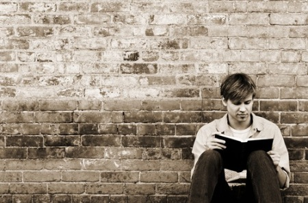young-man-reading-964491_894279473